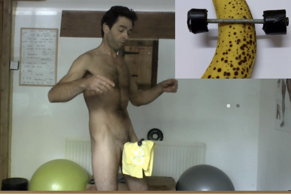 London Erection Coach lifting weights with penis